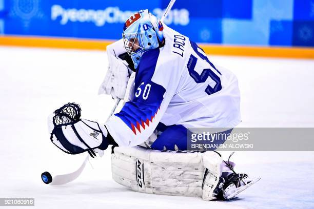 Slovakia's Jan Laco blocks the puck during the first period of the men's quarterfinals playoffs ice hockey match between the United States and...