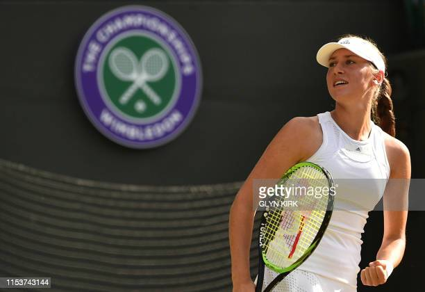 Slovakia's Kaja Juvan celebrates after winning a point against US player Serena Williams during their women's singles second round match on the...