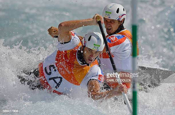 TOPSHOT Slovakia's Ladislav and Peter Skantar compete in the Men's C2 semifinal canoe slalom competition at the Whitewater stadium during the Rio...