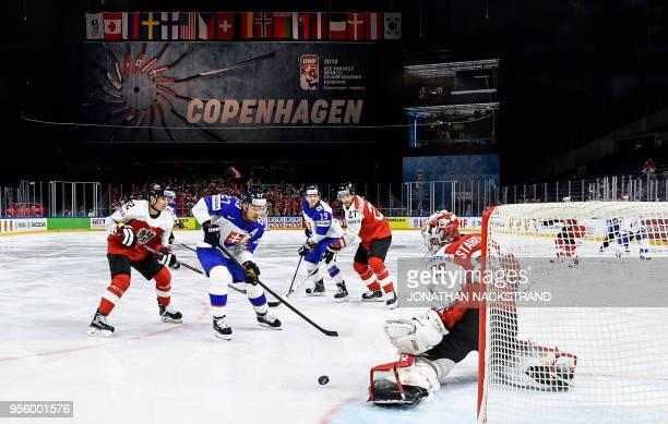 TOPSHOT Slovakia's Ladislav Nagy strikes in front of Austria's goalie Bernhard Starkbaum during the 2018 IIHF Men's Ice Hockey World Championship...