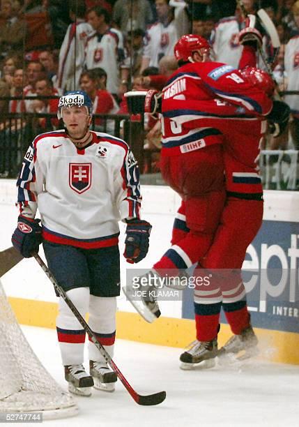 Slovakia's Lubomir Visnovsky looks on as Viktor Kozlov and Alexei Yashin celebrate Russia's goal to 3:3 during the Ice Hockey IIHF World Championship...