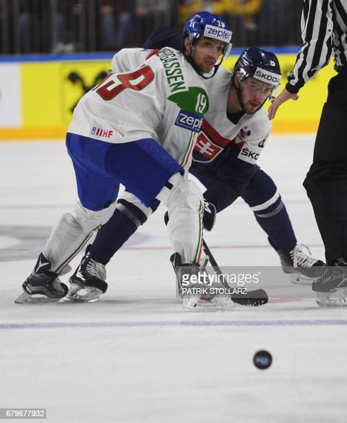 Slovakia´s Lukas Cingel and Italy´s Raphael Andergassen vie for the puck during the IIHF Ice hockey world championship first round match between...
