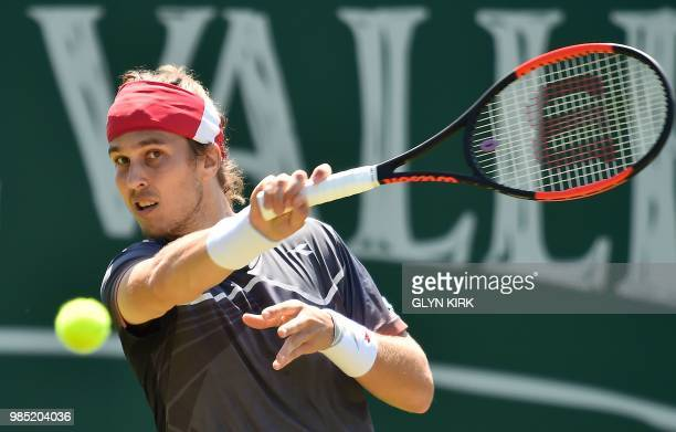 Slovakia's Lukas Lacko returns against Argentina's Diego Schwartzman during their Men's singles second round match at the ATP Nature Valley...