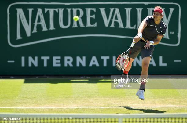 Slovakia's Lukas Lacko serves against Argentina's Diego Schwartzman during their Men's singles second round match at the ATP Nature Valley...