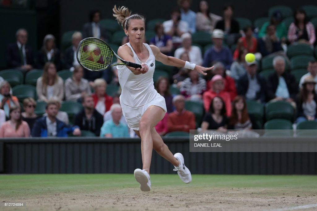 Slovakia's Magdalena Rybarikova returns against US player Coco Vandeweghe during their women's singles quarter-final match, after it re-commenced on a covered Centre Court, after rain delayed the match on Court One, on the eighth day of the 2017 Wimbledon Championships at The All England Lawn Tennis Club in Wimbledon, southwest London, on July 11, 2017. /