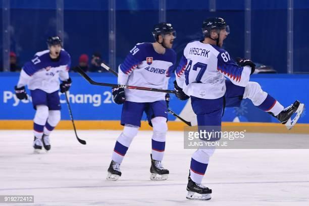 Slovakia's Marcel Hascak celebrates scoring in the men's preliminary round ice hockey match between Slovakia and Slovenia during the Pyeongchang 2018...