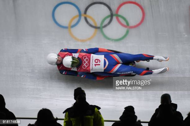 Slovakia's Marek Solcansky and Karol Stuchlak compete in the doubles luge run 1 during the Pyeongchang 2018 Winter Olympic Games at the Olympic...