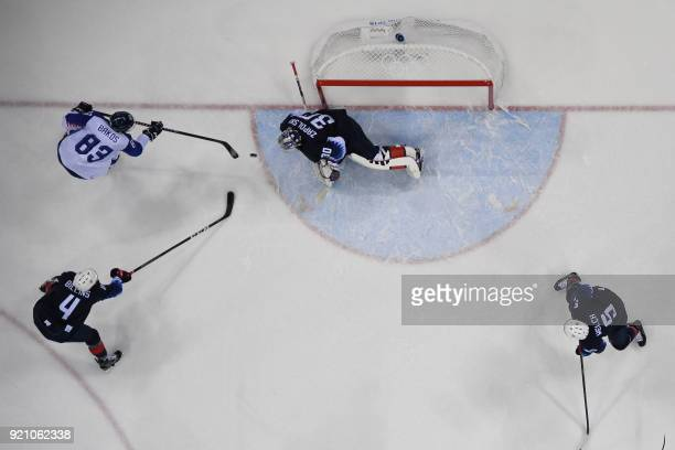 TOPSHOT Slovakia's Martin Bakos tries to score a goal in the men's playoff qualifications ice hockey match between the United States and Slovakia...