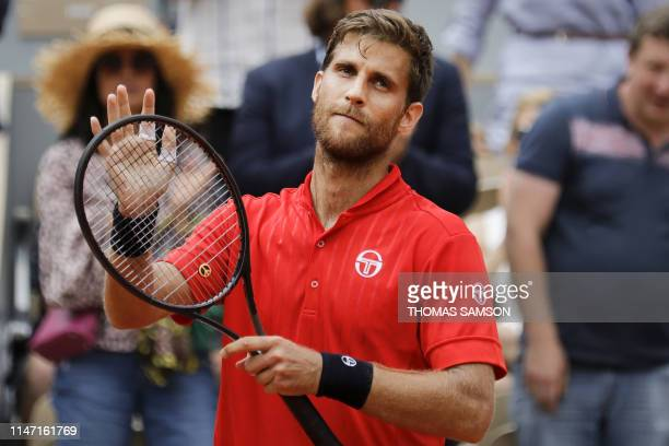 Slovakia's Martin Klizan celebrates after winning against France's Lucas Pouille during their men's singles second round match on day six of The...