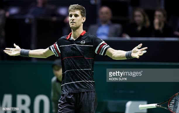 Slovakia's Martin Klizan celebrates his victory over France's Nicolas Mahut at the end of their Rotterdam ATP tournament tennis match on February 13...