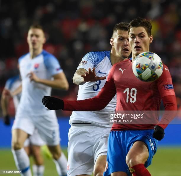 Slovakia's Martin Skrtel and Czech Republic's forward Patrik Schick vie for the ball during the UEFA Nations League football match Czech Republic v...