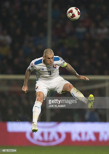 Slovakia's Martin Skrtel plays the ball during the EURO 2016 Group C qualifier football match Slovakia vs Luxembourg in Zilina Slovakia on March 27...