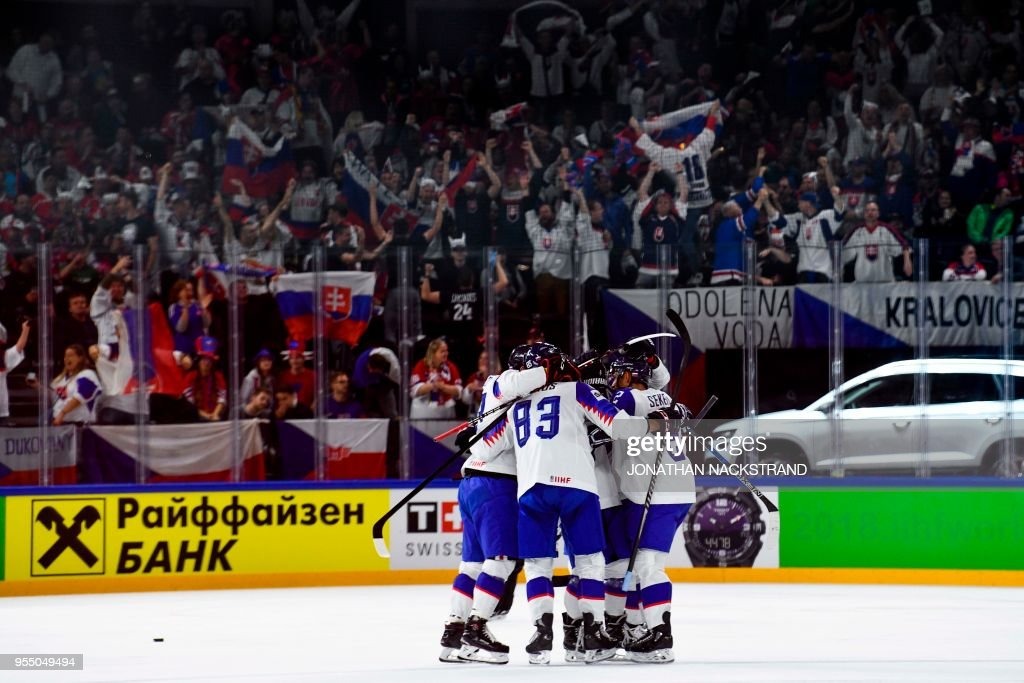 Slovakia's Michal Kristof #19 is congratulated by teamates after scoring a goal during the group A match Czech Republic vs Slovakia of the 2018 IIHF Ice Hockey World Championship at the Royal Arena in Copenhagen, Denmark, on May 5, 2018.