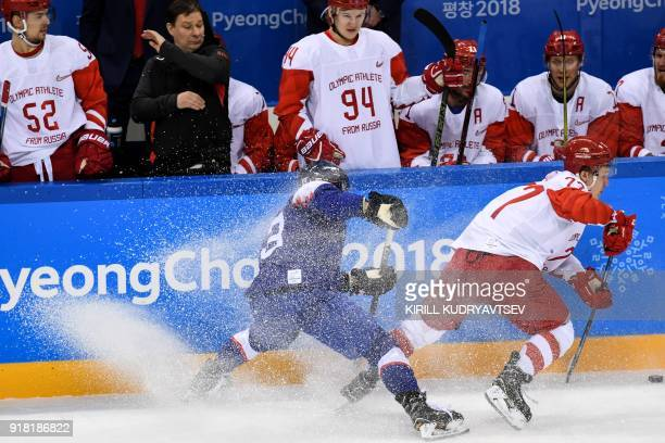 Slovakia's Michal Kristof vies with Russia's Kirill Kaprizov in the men's preliminary round ice hockey match between Slovakia and Olympic Athletes...