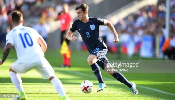 Slovakia's midfielder Albert Rusnak and England's Ben England's defender Ben Chilwell vie for the ball during the UEFA U21 European Championship...