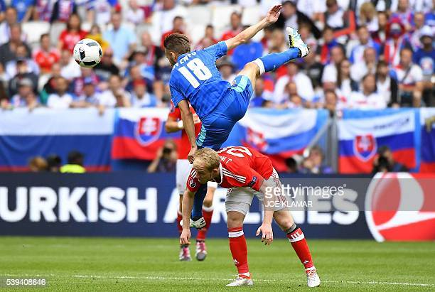 TOPSHOT Slovakia's midfielder Dusan Svento vies for the ball with Wales' midfielder Jonathan Williams during the Euro 2016 group B football match...