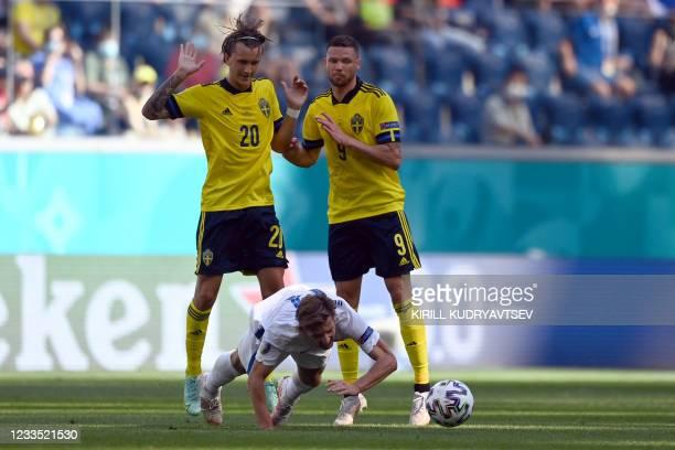 Slovakia's midfielder Juraj Kucka falls in front of Sweden's midfielder Kristoffer Olsson and Sweden's forward Marcus Berg during the UEFA EURO 2020...