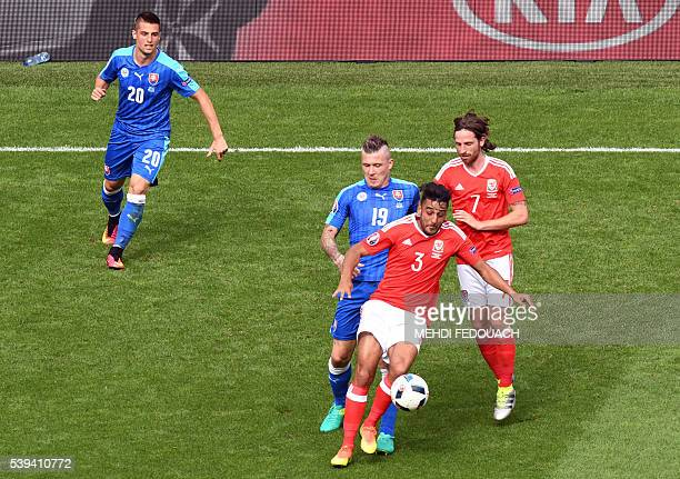 Slovakia's midfielder Juraj Kucka vies for the ball against Wales' defender Neil Taylor and Wales' midfielder Joe Allen during the Euro 2016 group B...