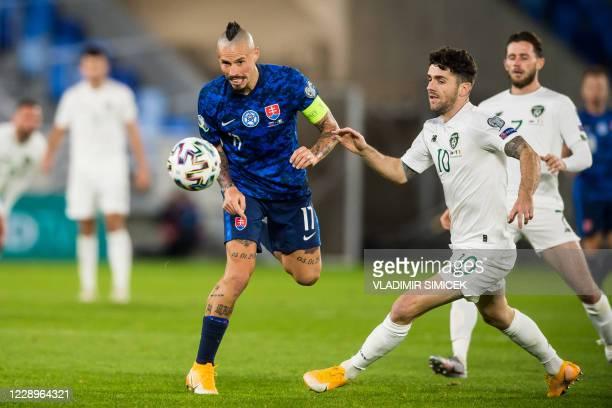 Slovakia's midfielder Marek Hamsik and Ireland's Robbie Brady vie for the ball during the Euro 2020 play-off semi-final football match between...