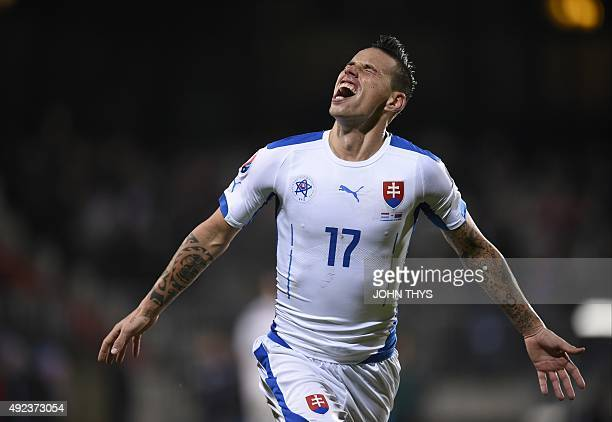 Slovakia's midfielder Marek Hamsik celebrates after scoring during the Euro 2016 qualifying football match between Luxembourg and Slovakia at the...