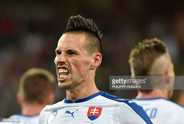 Slovakia's midfielder Marek Hamsik celebrates his goal his team's second goal during the Euro 2016 group B football match between Russia and Slovakia...