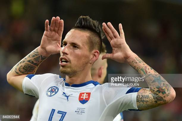 Slovakia's midfielder Marek Hamsik gestures as he celebrates his goal during the Euro 2016 group B football match between Russia and Slovakia at the...