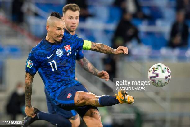 Slovakia's midfielder Marek Hamsik kicks the ball during the Euro 2020 play-off semi-final football match between between Slovakia and Republic of...