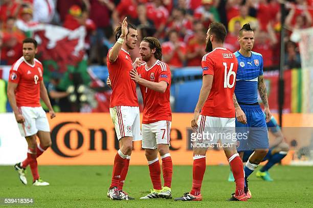 Slovakia's midfielder Marek Hamsik reacts as Wales' forward Gareth Bale Wales' midfielder Joe Allen and Wales' midfielder Joe Ledley celebrates after...