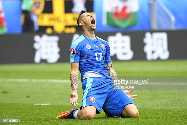 TOPSHOT Slovakia's midfielder Marek Hamsik reacts during the Euro 2016 group B football match between Wales and Slovakia at the Stade de Bordeaux in...