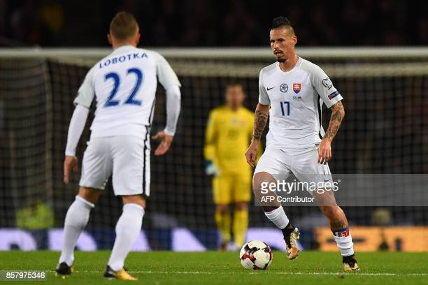 Slovakia's midfielder Marek Hamsik runs with the ball during the FIFA World Cup 2018 qualifying football match between Scotland and Slovakia at...