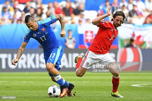 Slovakia's midfielder Marek Hamsik vies for the ball with Wales' midfielder Joe Allen during the Euro 2016 group B football match between Wales and...