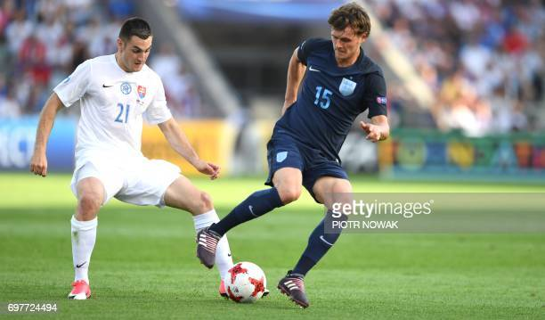 Slovakia's midfielder Matus Bero and England's midfielder John Swift vie for the ball during the UEFA U21 European Championship Group A football...