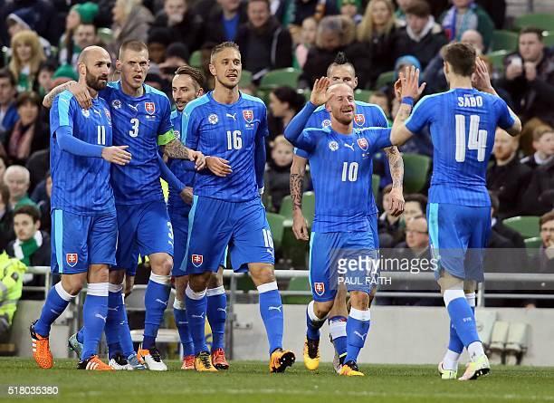 Slovakia's midfielder Miroslav Stoch celebrates scoring the opening goal during the international friendly football match between Republic of Ireland...