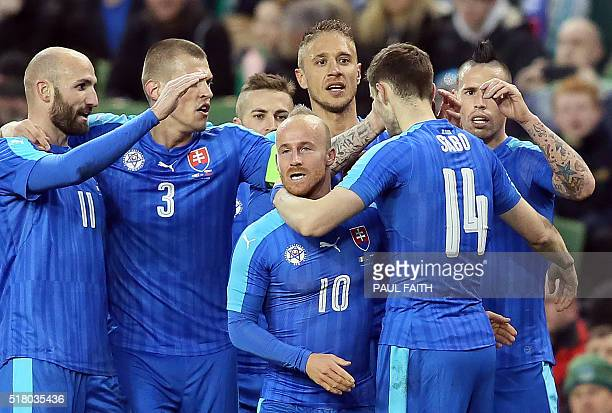 Slovakia's midfielder Miroslav Stoch celebrates scoring the opening goal during the international friendly football match between Republic of Ireland...