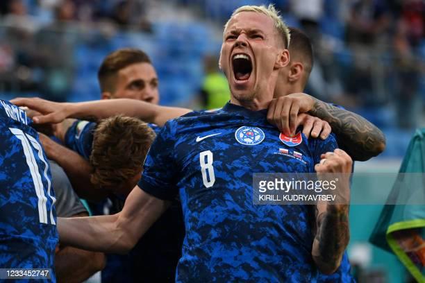 Slovakia's midfielder Ondrej Duda celebrates his team's second goal during the UEFA EURO 2020 Group E football match between Poland and Slovakia at...