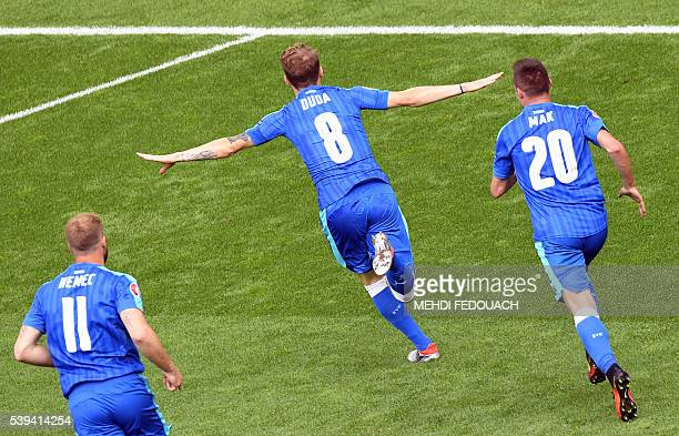 TOPSHOT Slovakia's midfielder Ondrej Duda celebrates the team's first goal during the Euro 2016 group B football match between Wales and Slovakia at...