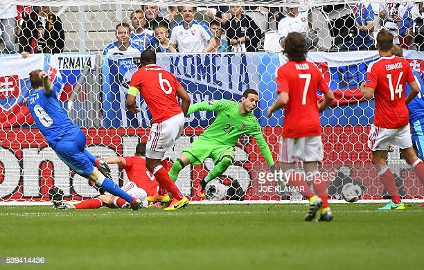 Slovakia's midfielder Ondrej Duda shoots and scores his team's first goal during the Euro 2016 group B football match between Wales and Slovakia at...