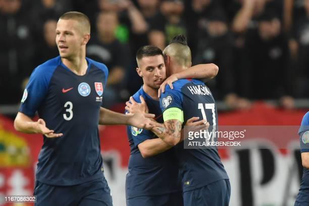 Slovakia's midfielder Robert Mak celebrates scoring with midfielder Marek Hamsik and defender Denis Vavro during the UEFA Euro 2020 Group E...