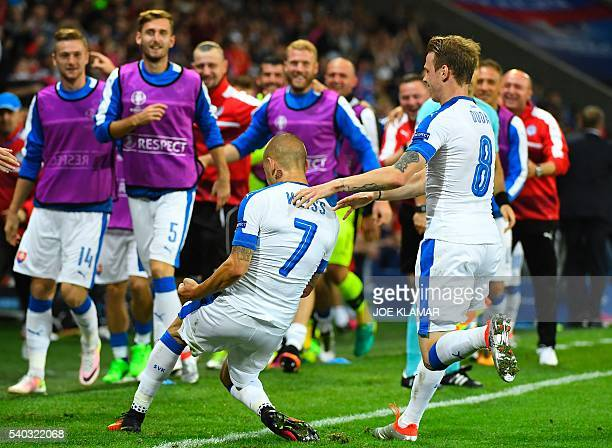 Slovakia's midfielder Vladimir Weiss celebrates a goal with teammates during the Euro 2016 group B football match between Russia and Slovakia at the...