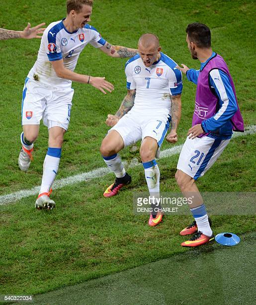 Slovakia's midfielder Vladimir Weiss celebrates his goal with teammates during the Euro 2016 group B football match between Russia and Slovakia at...