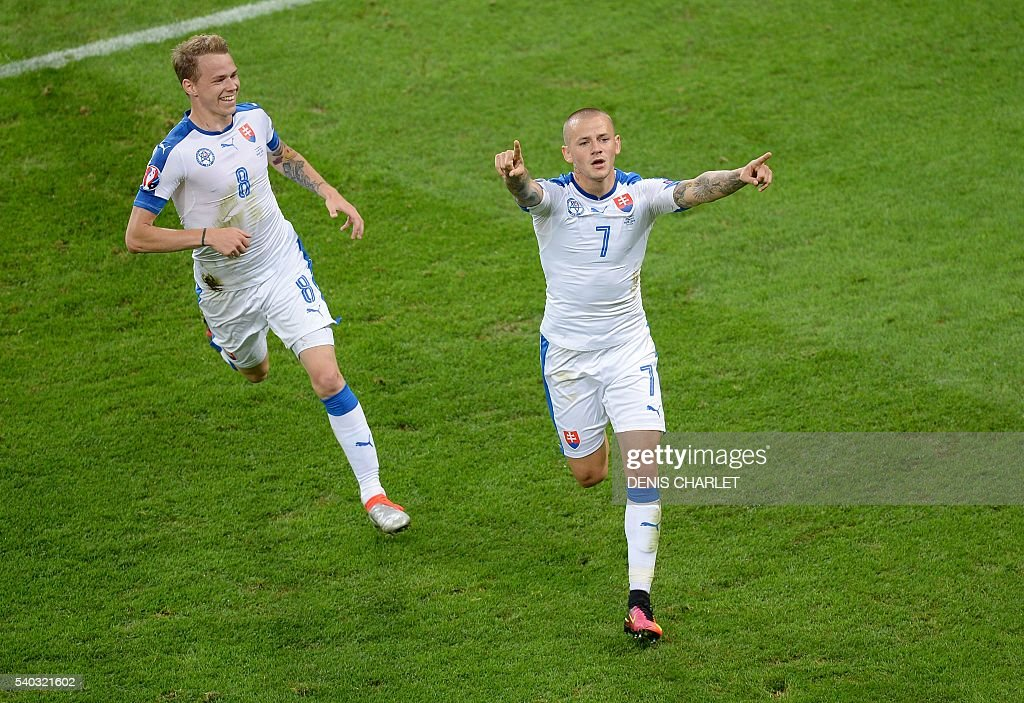 Slovakia's midfielder Vladimir Weiss (R) celebrates his opening goal during the Euro 2016 group B football match between Russia and Slovakia at the Pierre-Mauroy Stadium in Villeneuve-d'Ascq, near Lille, on June 15, 2016. / AFP / DENIS