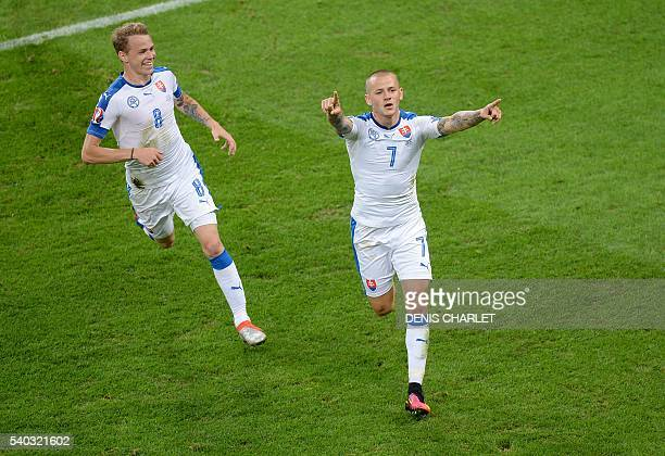 Slovakia's midfielder Vladimir Weiss celebrates his opening goal during the Euro 2016 group B football match between Russia and Slovakia at the...