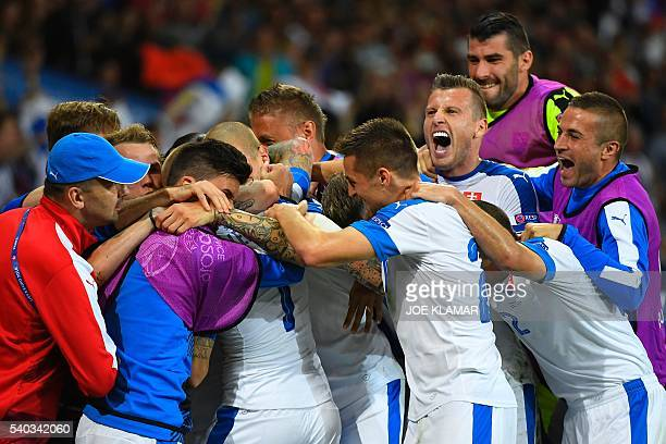 Slovakia's midfielder Vladimir Weiss celebrates with team mates during the Euro 2016 group B football match between Russia and Slovakia at the...