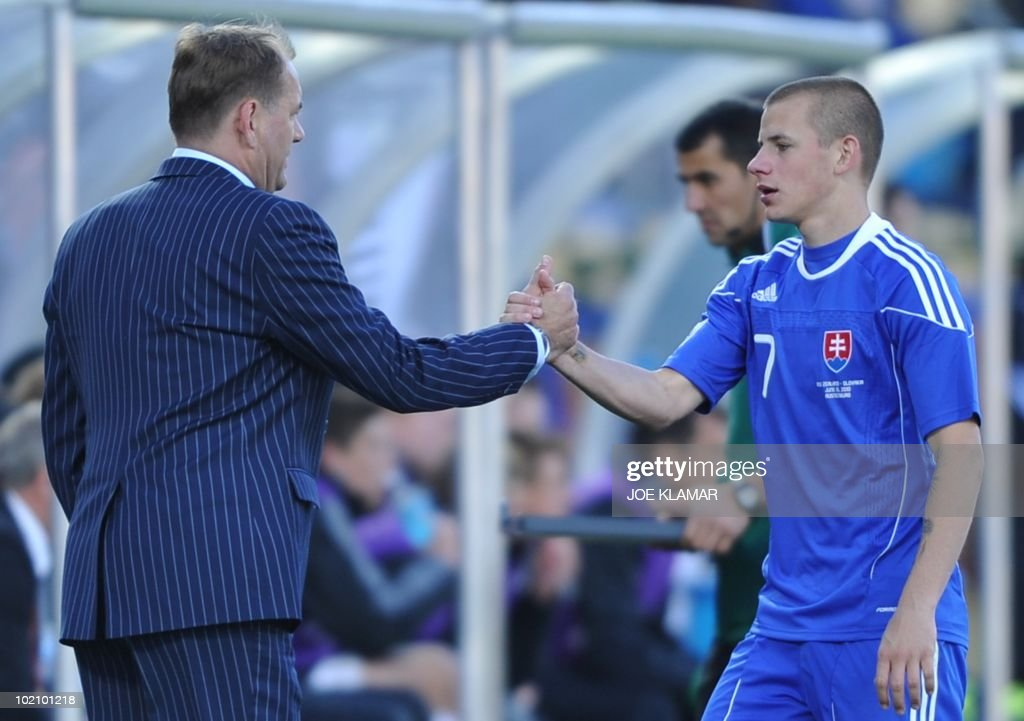 Slovakia's midfielder Vladimir Weiss (R) is congratulated by Slovakia's coach Vladimir Weiss during the Group F first round 2010 World Cup football match New Zealand vs. Slovakia on June 15, 2010 at Royal Bafokeng stadium in Rustenburg. NO