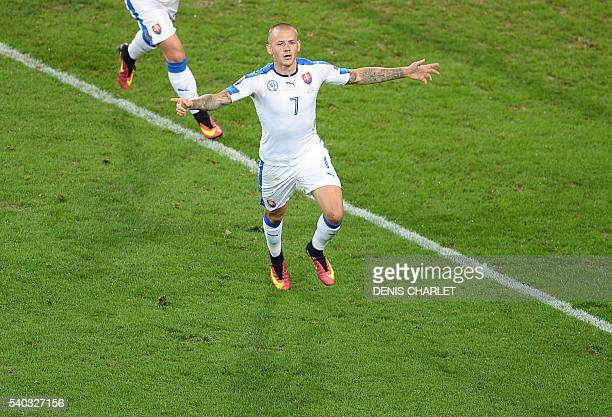Slovakia's midfielder Vladimir Weiss runs to celebrate his teams first goal during the Euro 2016 group B football match between Russia and Slovakia...