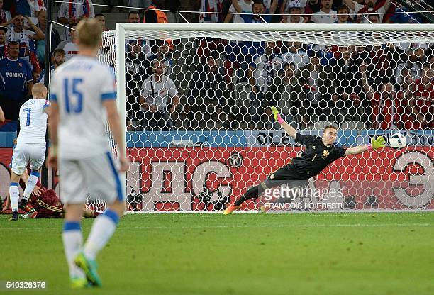 Slovakia's midfielder Vladimir Weiss shoots to score past Russia's goalkeeper Igor Akinfeev during the Euro 2016 group B football match between...