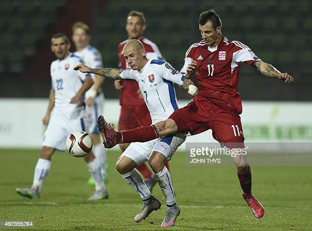Slovakia's midfielder Vladimir Weiss vies with Luxembourg's forward Stefano Bensi during the Euro 2016 qualifying football match between Luxembourg...