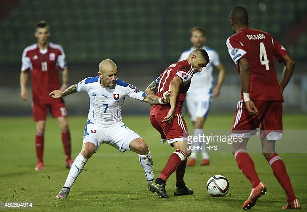 Slovakia's midfielder Vladimir Weiss vies with Luxembourg's midfielder Mario Mutsch during the Euro 2016 qualifying football match between Luxembourg...