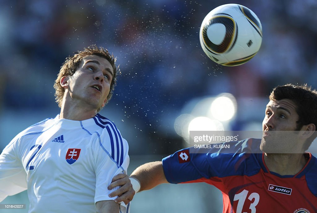 Slovakia's national team player Peter Pekarik (L) and Costarican national team player Gonzalo Segares fight for the ball during their friendly match in Bratislava on June 5, 2010 ahead of the 2010 FIFA World Cup in South Africa.