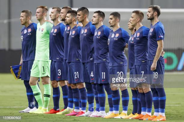 Slovakia's national team players sing their national anthem during the UEFA Nations League, league B group 2, football match between Israel and...